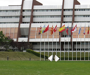 Council of Europe building with row of international flags