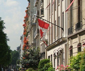 Candian flag hanging from a building